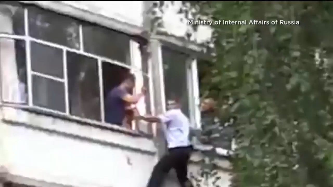Police Officer Rescues Baby From Being Thrown From Window