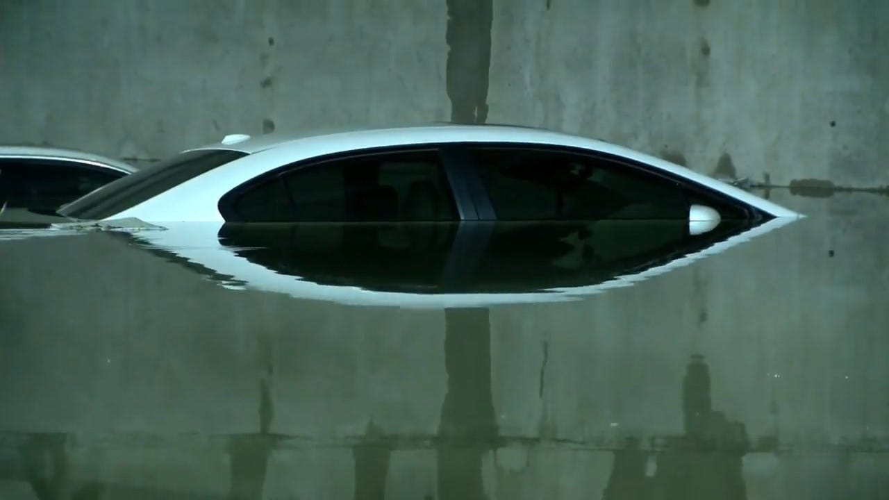 Flash Flooding Damages Vehicles In Dallas Airport Parking Garage