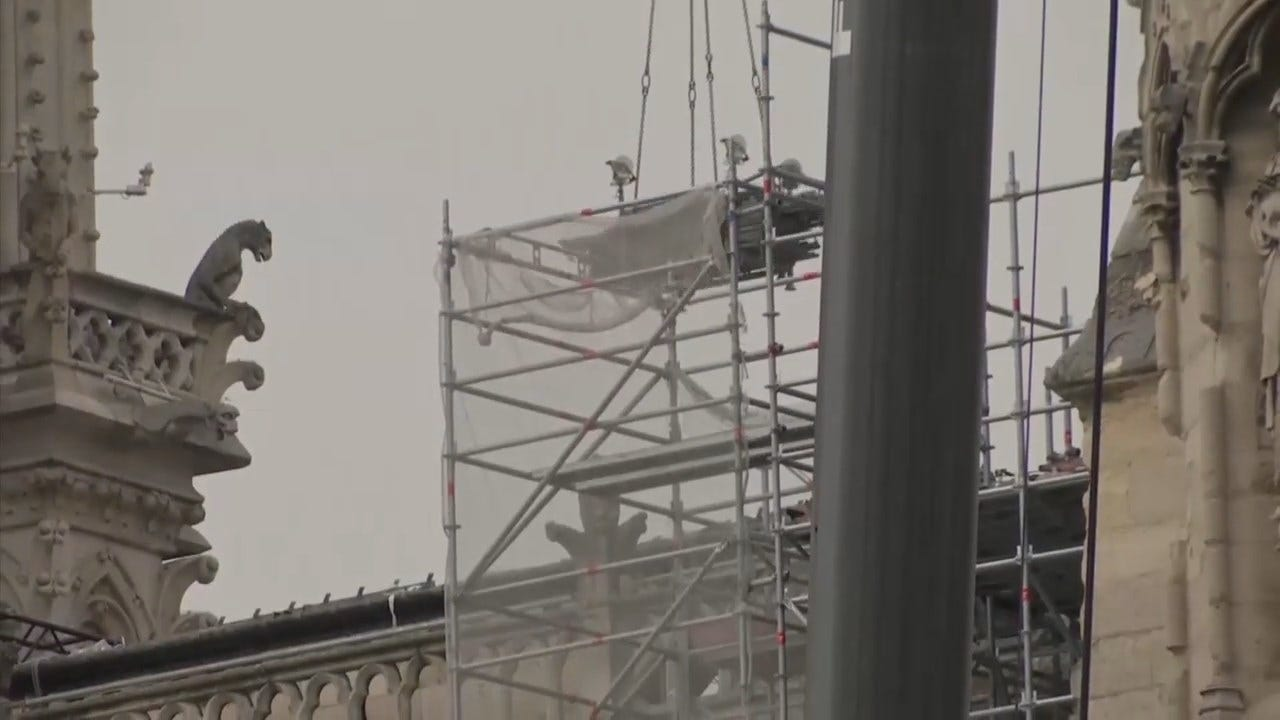 Workers Install Temporary Tarps To Save Notre Dame From Potential Rain Damage