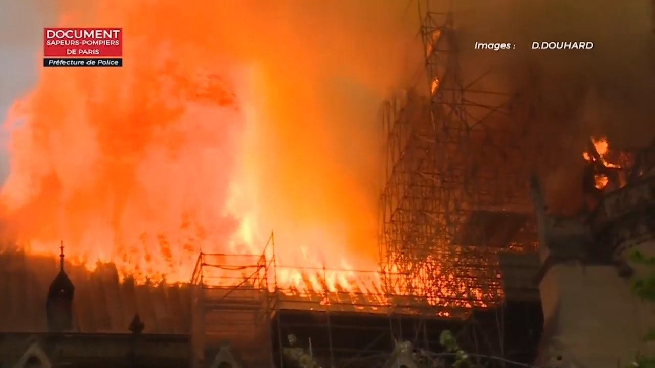 French President Vows To Rebuild After Fire Destroys Part Of Notre Dame Cathedral