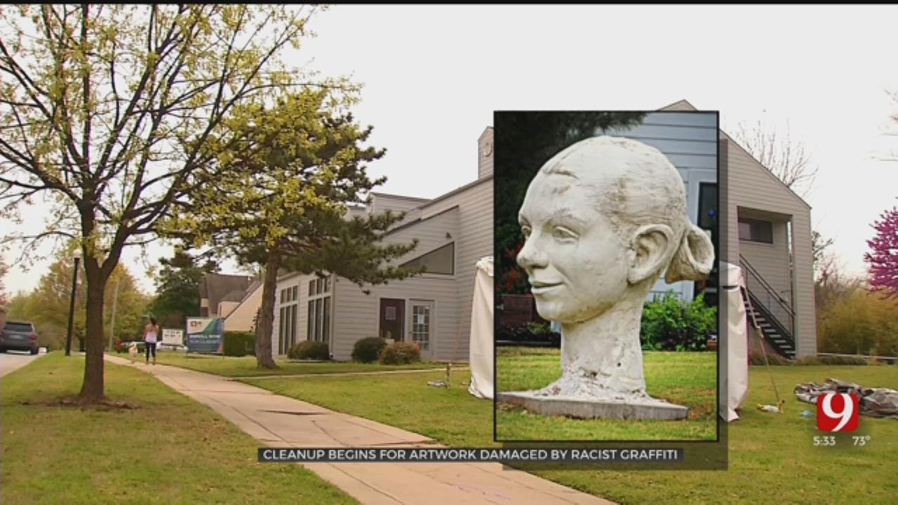 Artist Begins Cleanup Of Racist Vandalism On Norman Sculpture