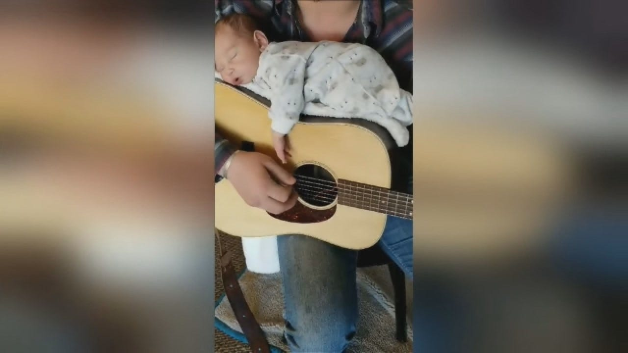 Dad Plays Guitar With Baby, Lulls Her To Sleep
