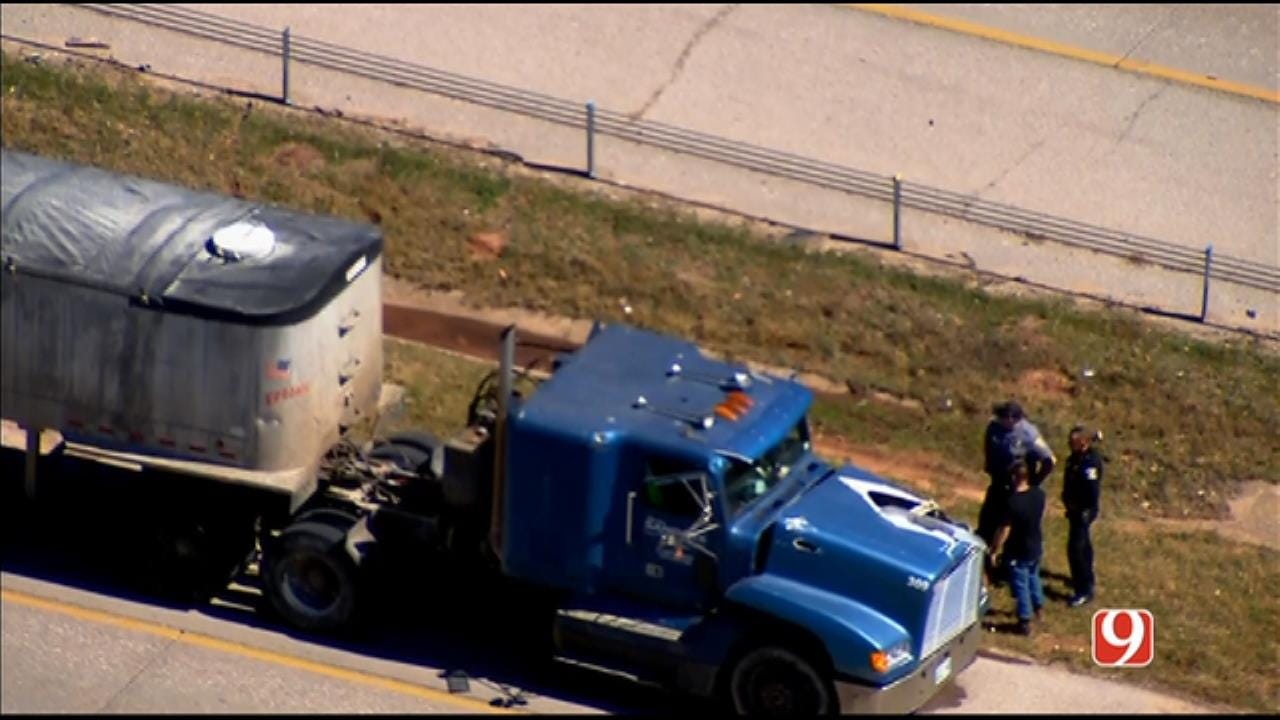Blown Over Light Pole Strikes Passing Semi