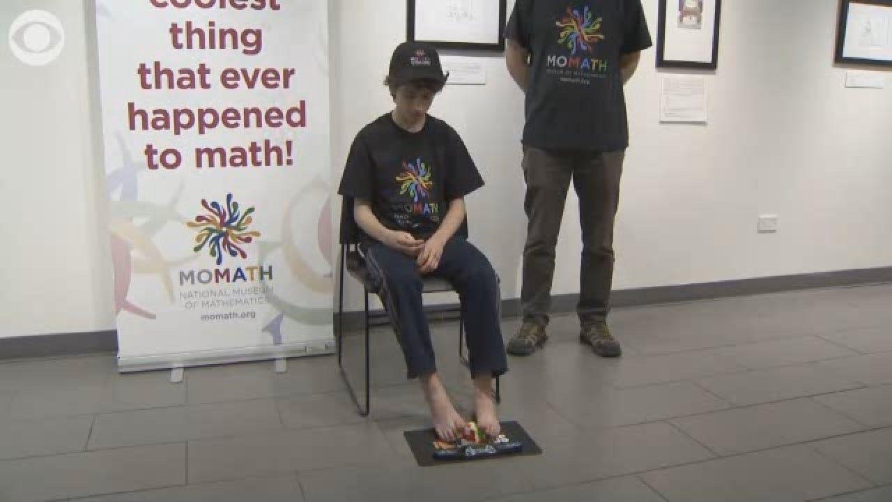 Brooklyn Teen Solves Rubik's Cube With His Feet
