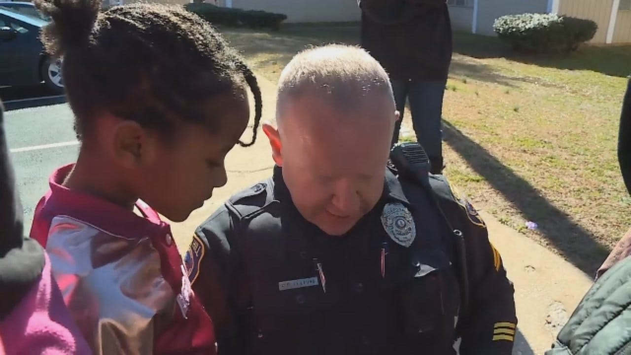 Mother Says Cop Changed Daughter's Life After Checking On Kids, Staying To Play