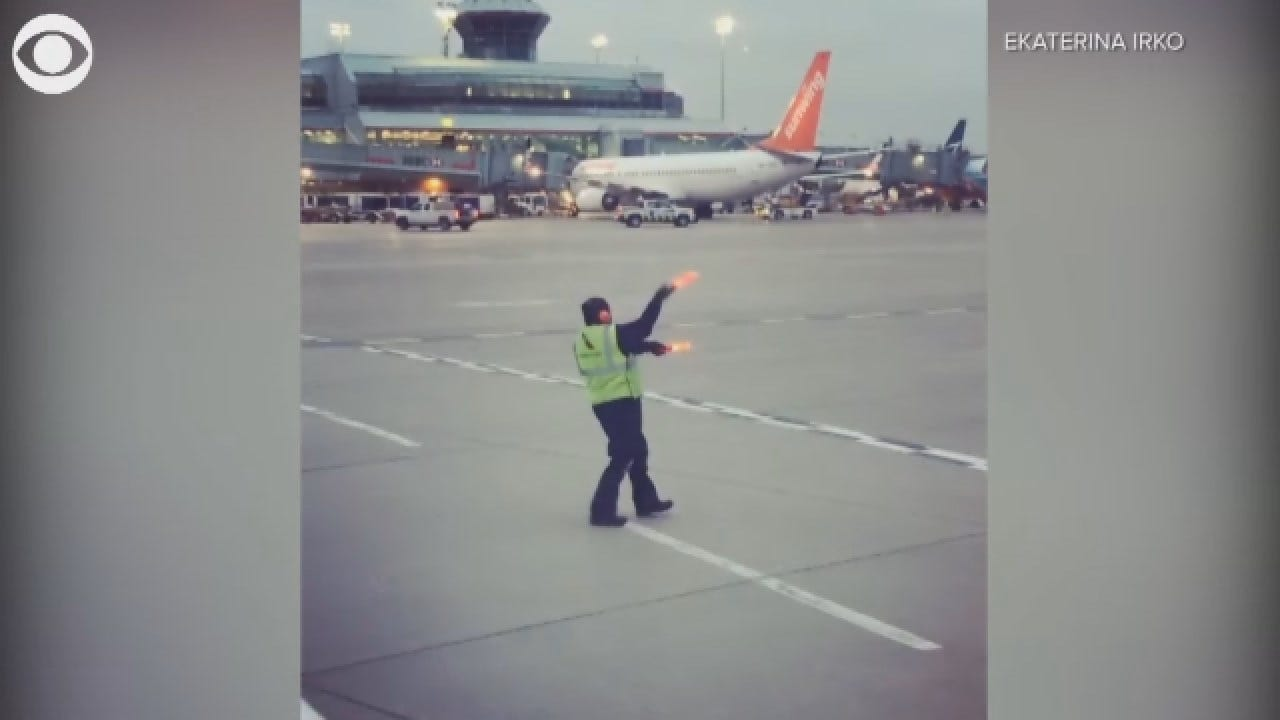 Airline Worker Does Silly Dance To Try To Cheer Up Crying Baby