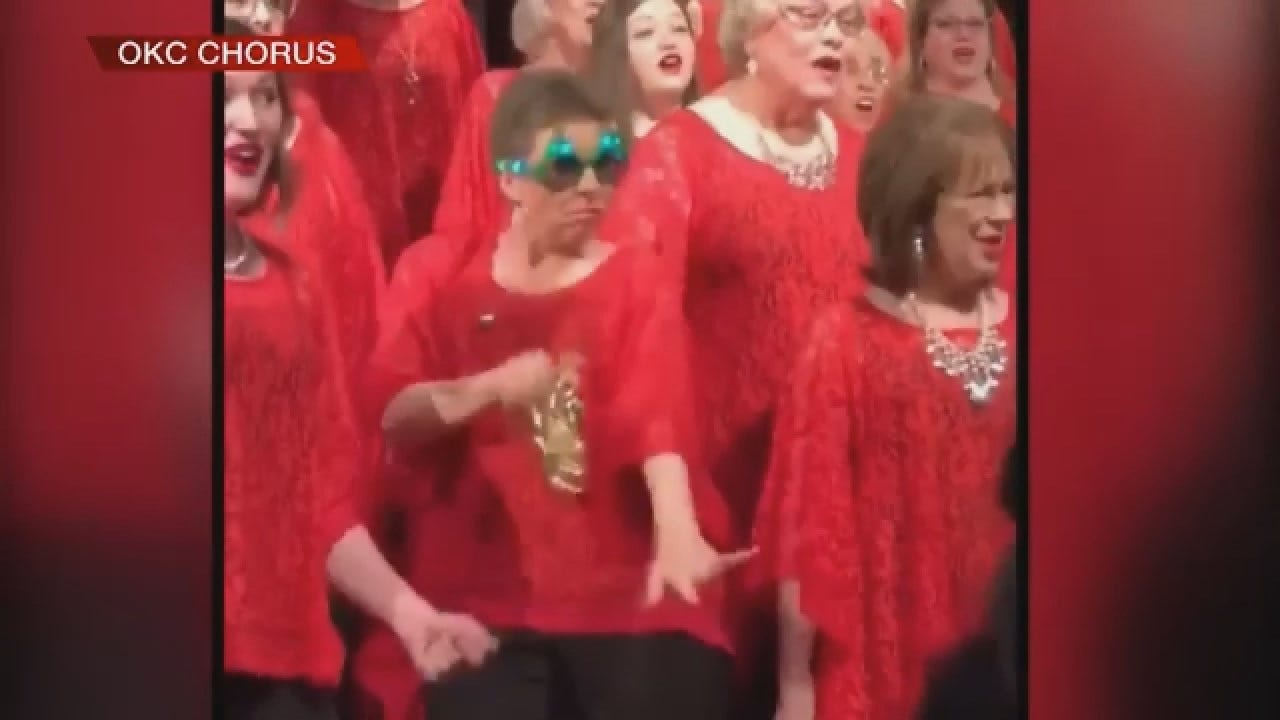 Woman Jingles Bells During OK City Chorus Concert