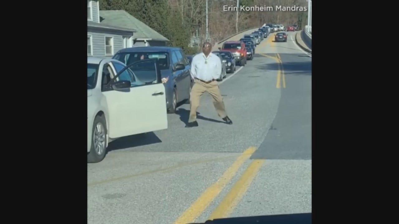 Man Dances In Standstill Traffic On Street In Baltimore