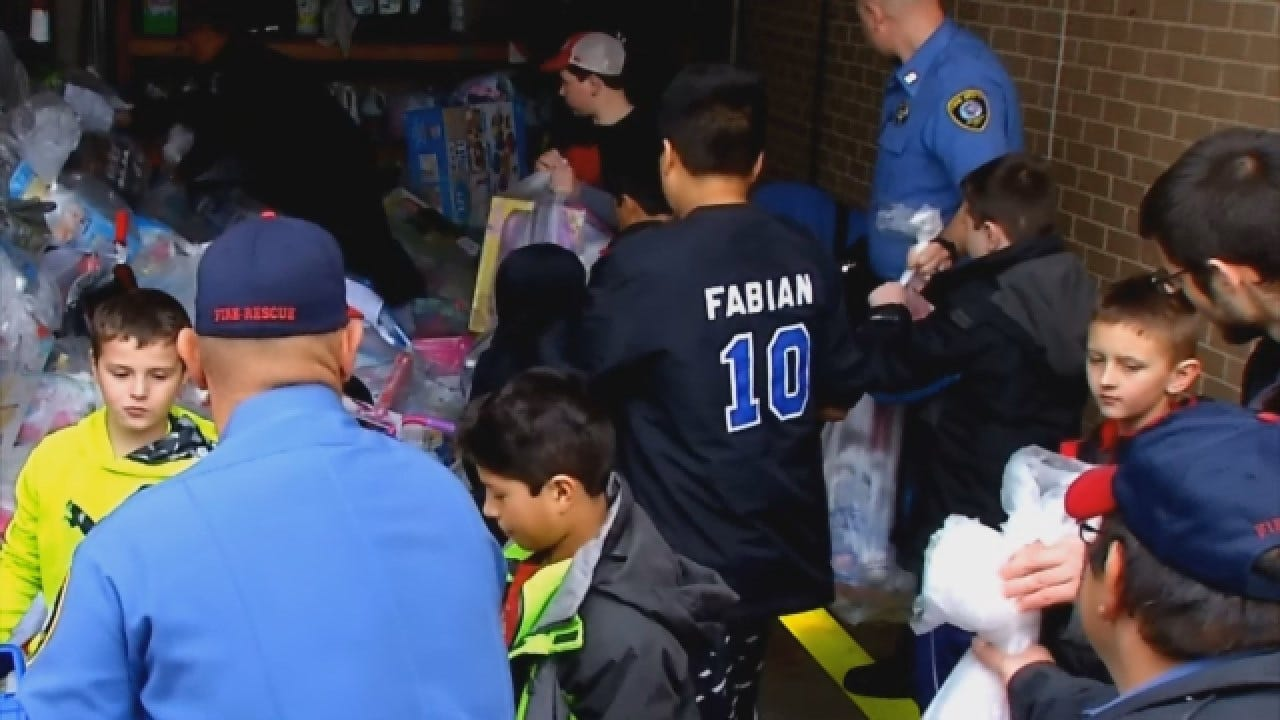 OKC Firefighters Donate Toys To Help 500 Foster Kids Have A Merry Christmas