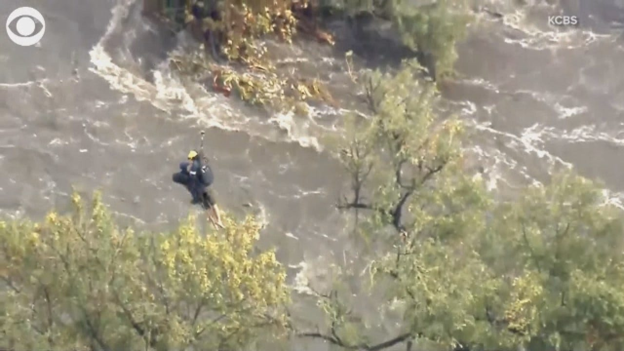 Firefighter Rescues California Man Trapped By Flooding