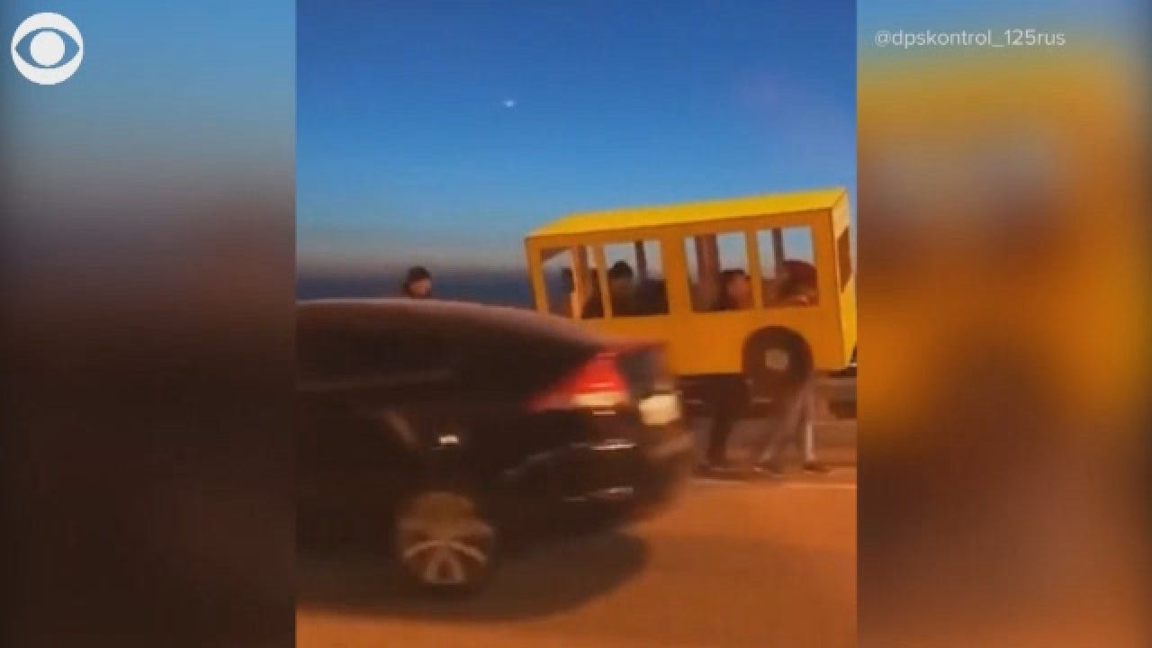 Russian Pedestrians Disguise Themselves As Bus For Vehicle Only Bridge