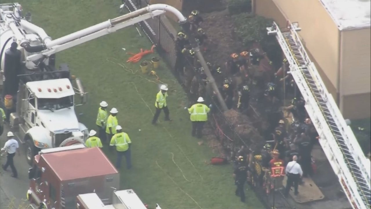 Raw Video: Rescue Workers Try To Save Worker Trapped In Trench