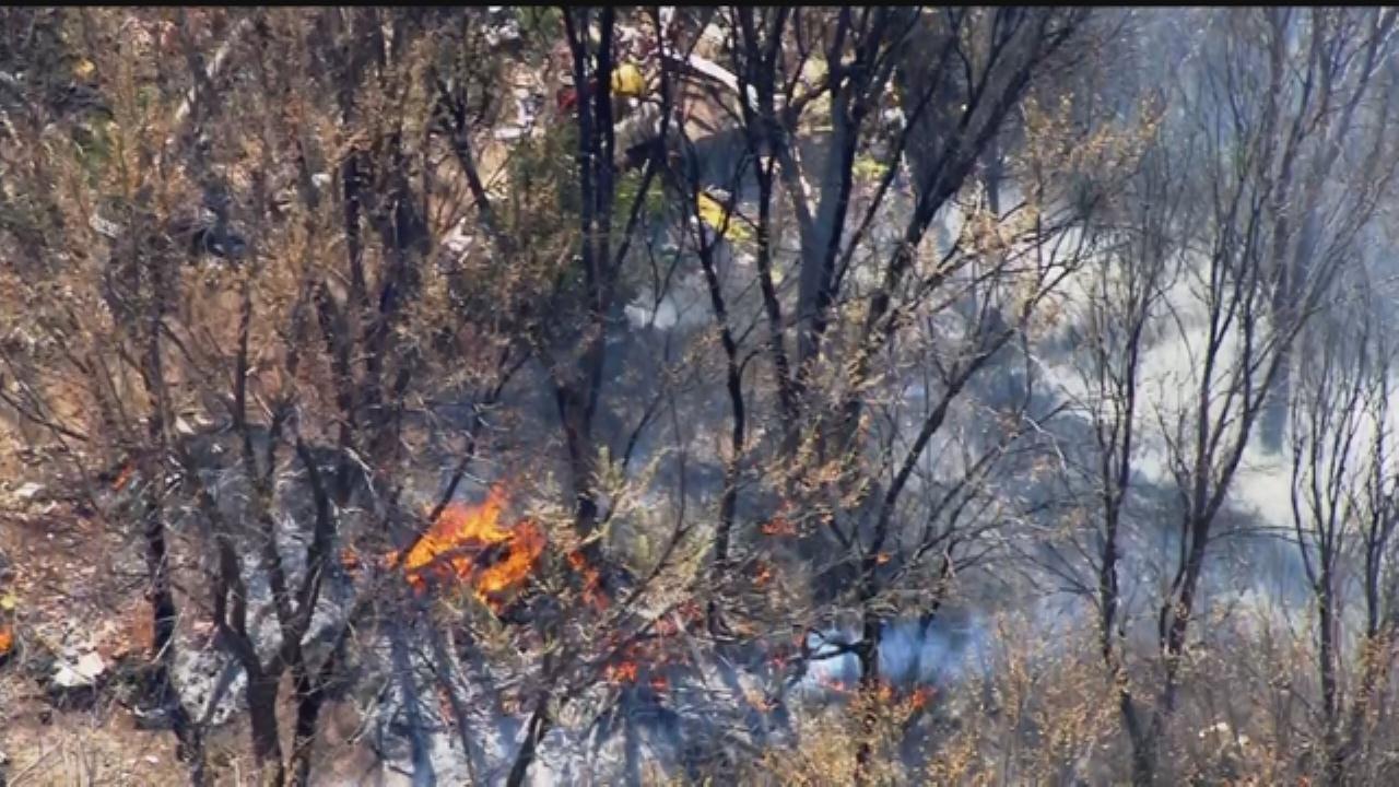 WEB EXTRA: SkyNews 9 Flies Over Grass Fire At 'Homeless Camp'