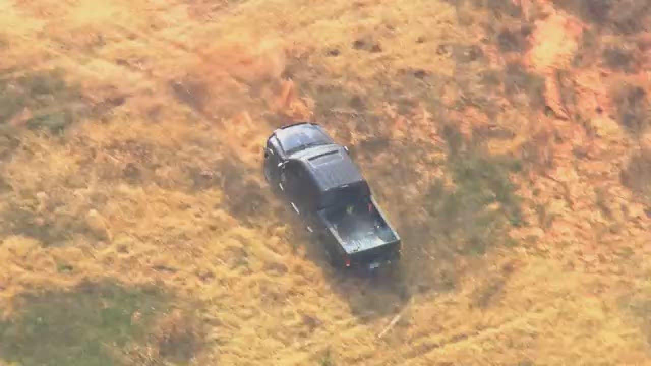 Black Truck Chase Pond Crash.wmv