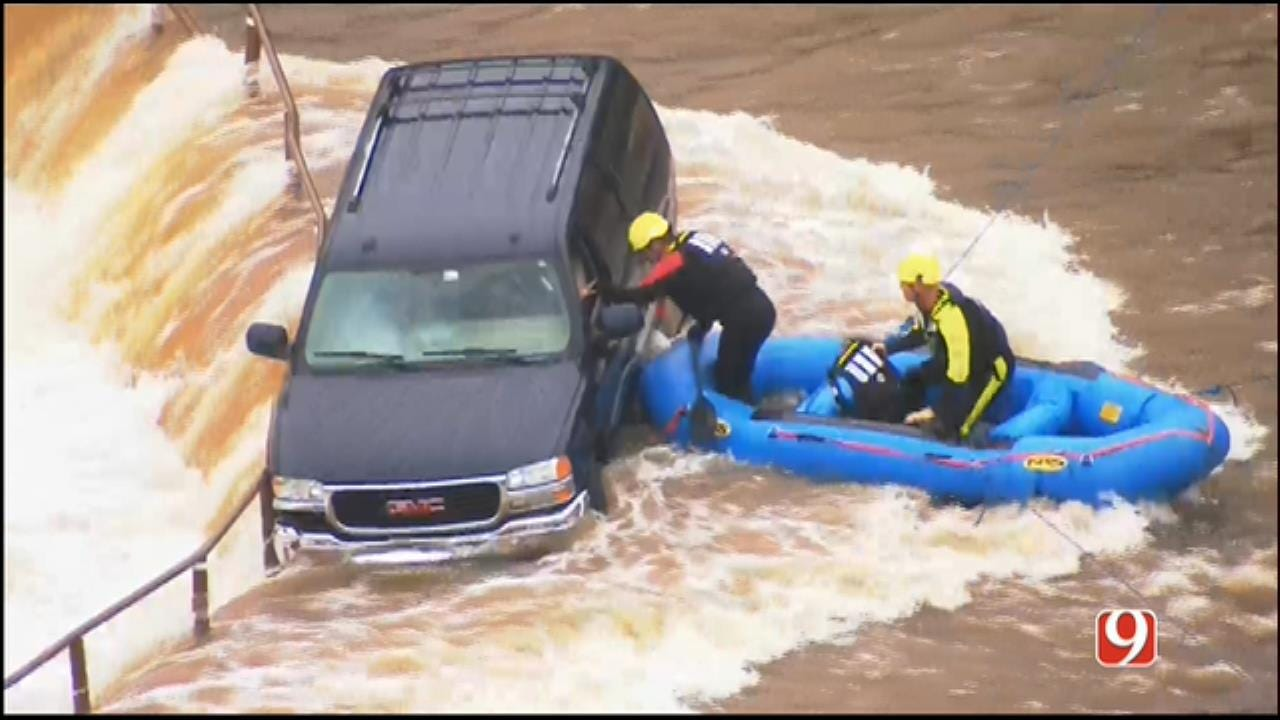 WEB EXTRA: Crews Rescue SUV Driver, Trapped On Flooded Spillway