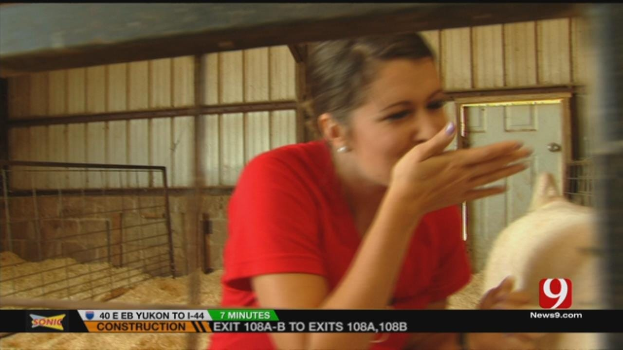 Lacey Swope Kisses The Pig