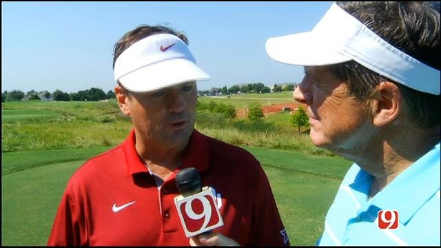 Bob Stoops Talks With Dean Blevins At the Sooner Golf Outing on Thursday
