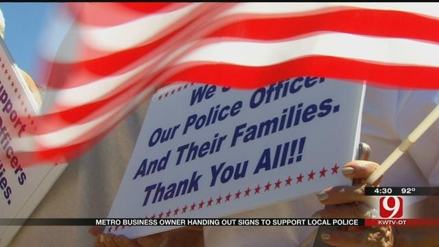 Metro Business Owner Handing Out Signs To Support Local Police