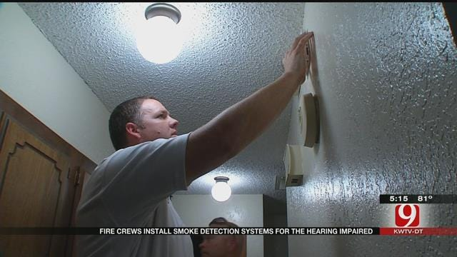 Metro Fire Crews Install Smoke Detectors For The Hearing Impaired
