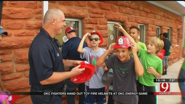 OKC Firefighters Hand Out Toy Helmets At Energy Game