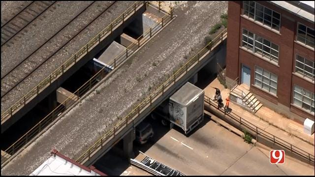 WEB EXTRA: SkyNews 9 Flies Over Semi Stuck Under Downtown Railroad Bridge