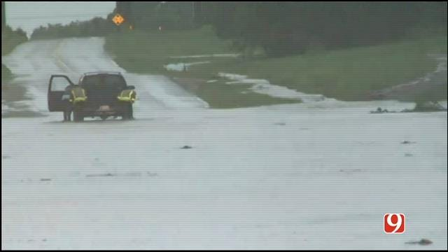 WEB EXTRA: Crews Push Vehicle Out Of Flood Waters