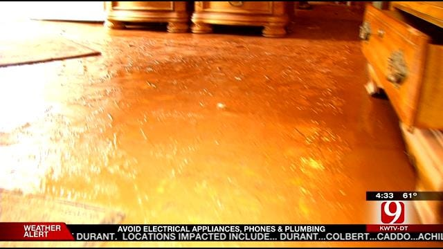 High Flood Waters Leave Some Purcell Homes Covered In Mud
