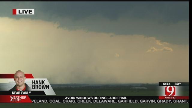 WEB EXTRA: News 9 Storm Tracker Hank Brown Captures Small Tornado Touchdown