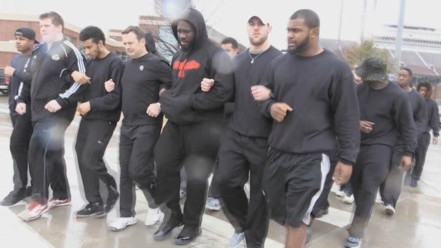 OU Players Lock Arms In Unity During Scheduled Spring Practice