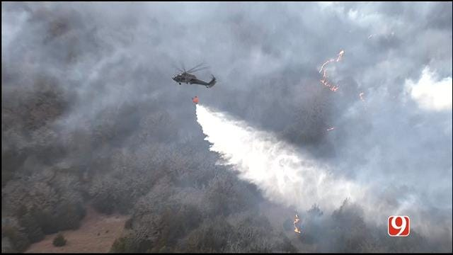 WEB EXTRA: Black Hawks Air Drop Water On Logan County Wild Fires