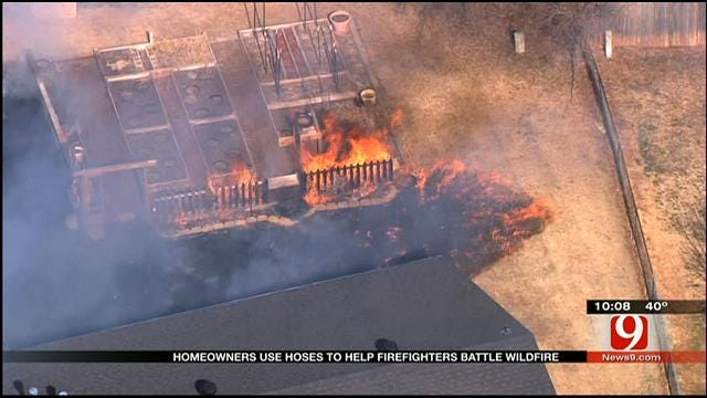 Homeowners Assist Firefighters During Wildfire
