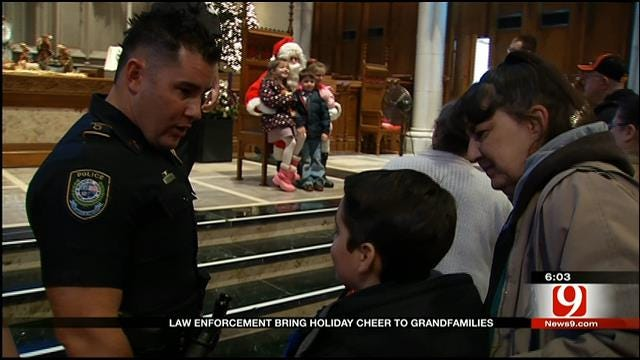 Law Enforcement Officers Bring Christmas Cheer To Metro Kids