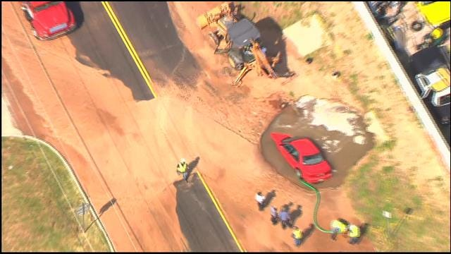 WEB EXTRA: Car Crashes Into Sinkhole In Downtown Oklahoma City