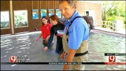 Kelly Ogle, Amanda Taylor Feed Stingrays At OKC Zoo