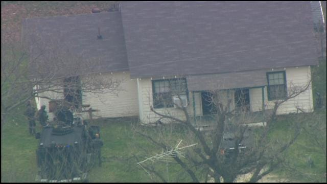 WEB EXTRA: Authorities Crash Into House With Homicide Suspect