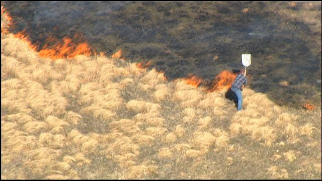 Man Tries To Beat Back Harrah Grass Fire With Shovel