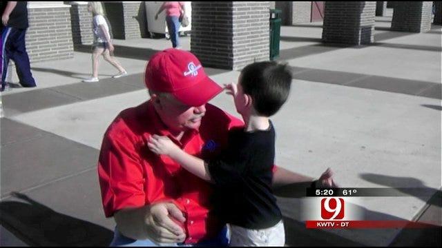 Woodward Boy Hugs, Thanks Storm Tracker Marty Logan