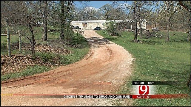 Cache Of Guns, Drugs Found During Raid