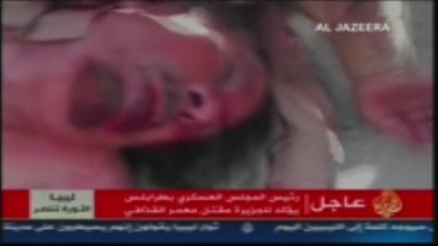 WARNING: Graphic Video Of Muammar Qaddafi's Death