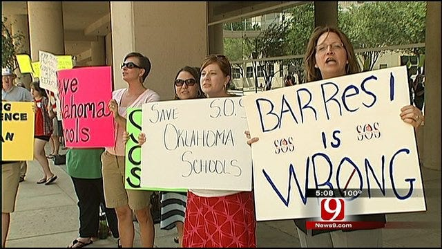 Protesters Oppose Superintendent's Budget Cuts