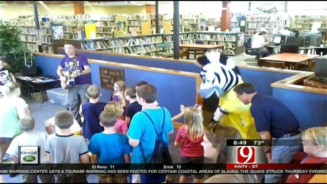 Jed Castles Cuts A Rug At The Weatherford Public Library