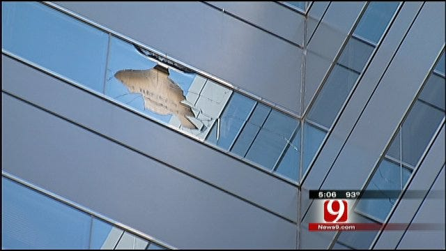Construction Debris Falls From Devon Tower, Through Window Of Another Building