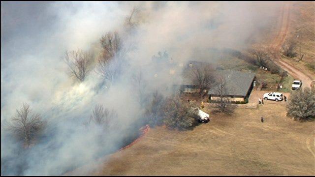 WEB EXTRA: Fire Races Toward Home Near Goldsby