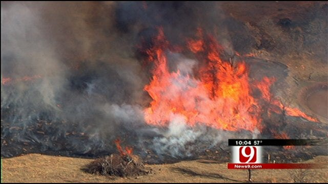 Several Fire Departments Fight Rekindled Luther Grass Fire