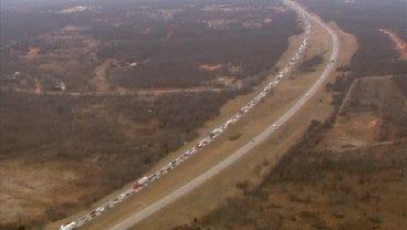 Plywood Scattered Across I-40 Backs Up Traffic For Miles
