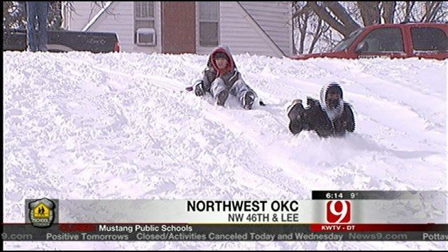 Kids Soak Up Snow Day Sledding