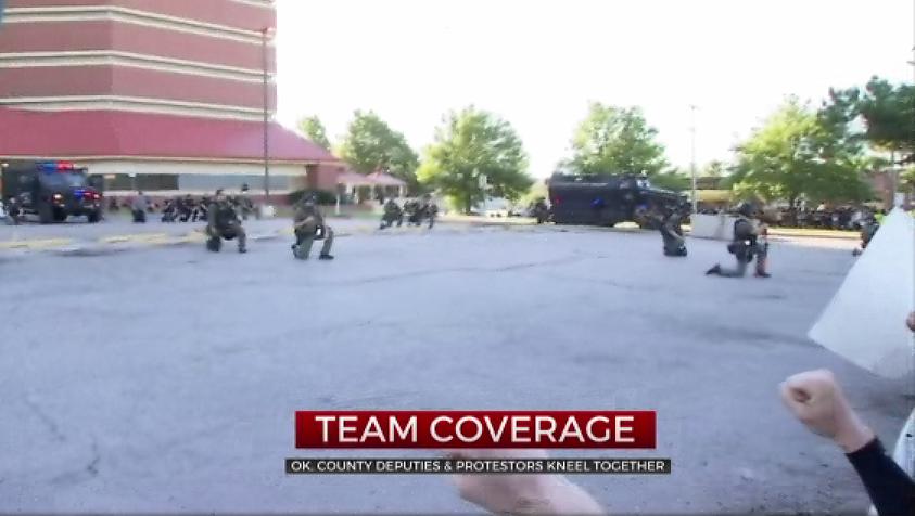 Oklahoma County Deputies, Protesters Kneel Together