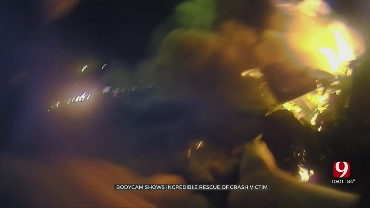 WATCH: Officers Save Victim From Burning Vehicle After Crash On I-35