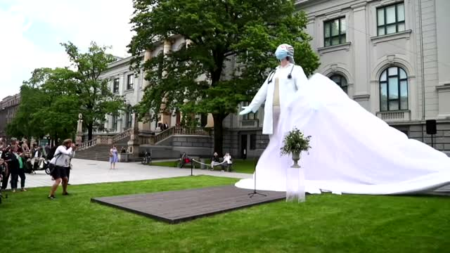 WATCH: Statue Of Medical Worker Unveiled In Latvia
