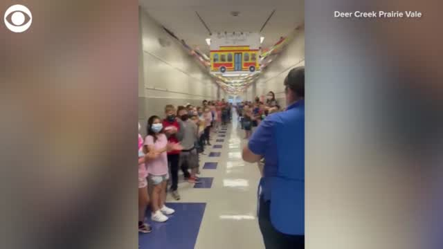 WATCH: Elementary School Students Cheer Cafeteria Manager After She Passes Her Citizenship Test